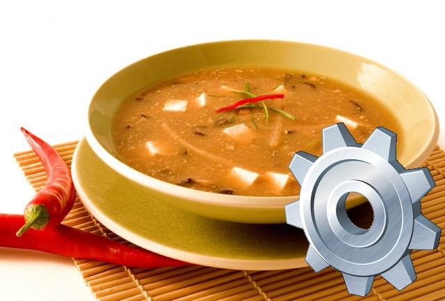 Teller Suppe mit einem Zahnrad-Symbol im Vordergrund