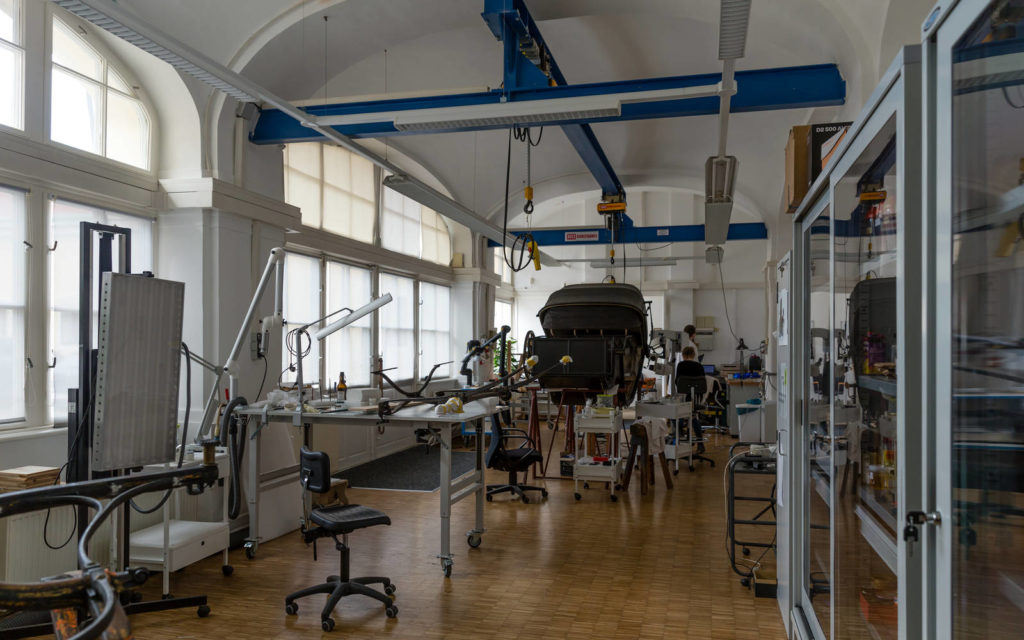 The bright conservation studio at the Imperial Carriage Museum is large enough to accommodate entire carriages.