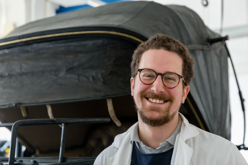 Matthias Manzini in the workshop in front of his restoration project.