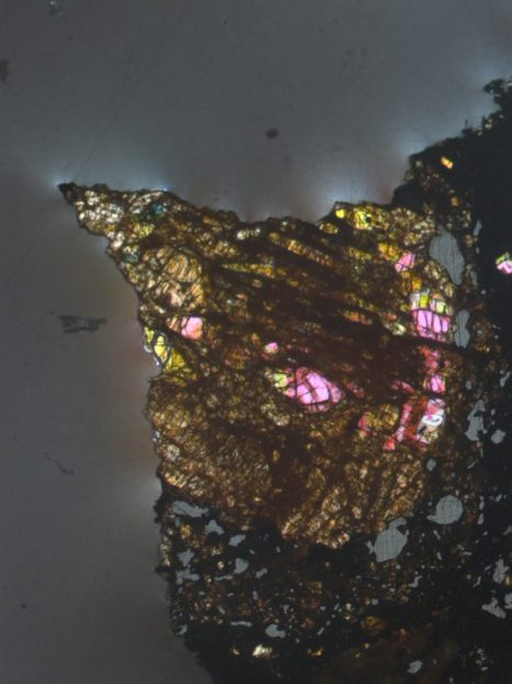 An igneous chondrule in the border of LAP 02342 CR2 chondrite